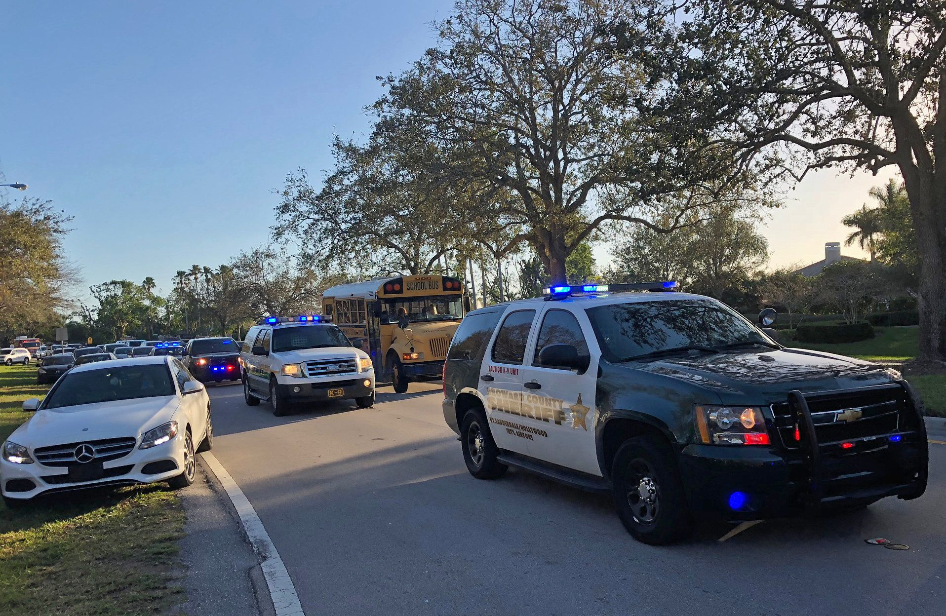 Sheriff vehicles are seen at Marjory Stoneman Douglas High School in Parkland, Florida, a city about 50 miles (80 kilometers) north of Miami on February 14, 2018 following a school shooting. A gunman opened fire at the Florida high school, an incident that officials said caused 'numerous fatalities' and left terrified students huddled in their classrooms, texting friends and family for help. The Broward County Sheriff's Office said a suspect was in custody. / AFP PHOTO / Michele Eve SANDBERG        (Photo credit should read MICHELE EVE SANDBERG/AFP/Getty Images)