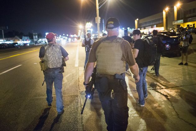 Oath Keepers carry rifles in Ferguson, Missouri, on Aug. 10, 2015. Demonstrators were protesting there...