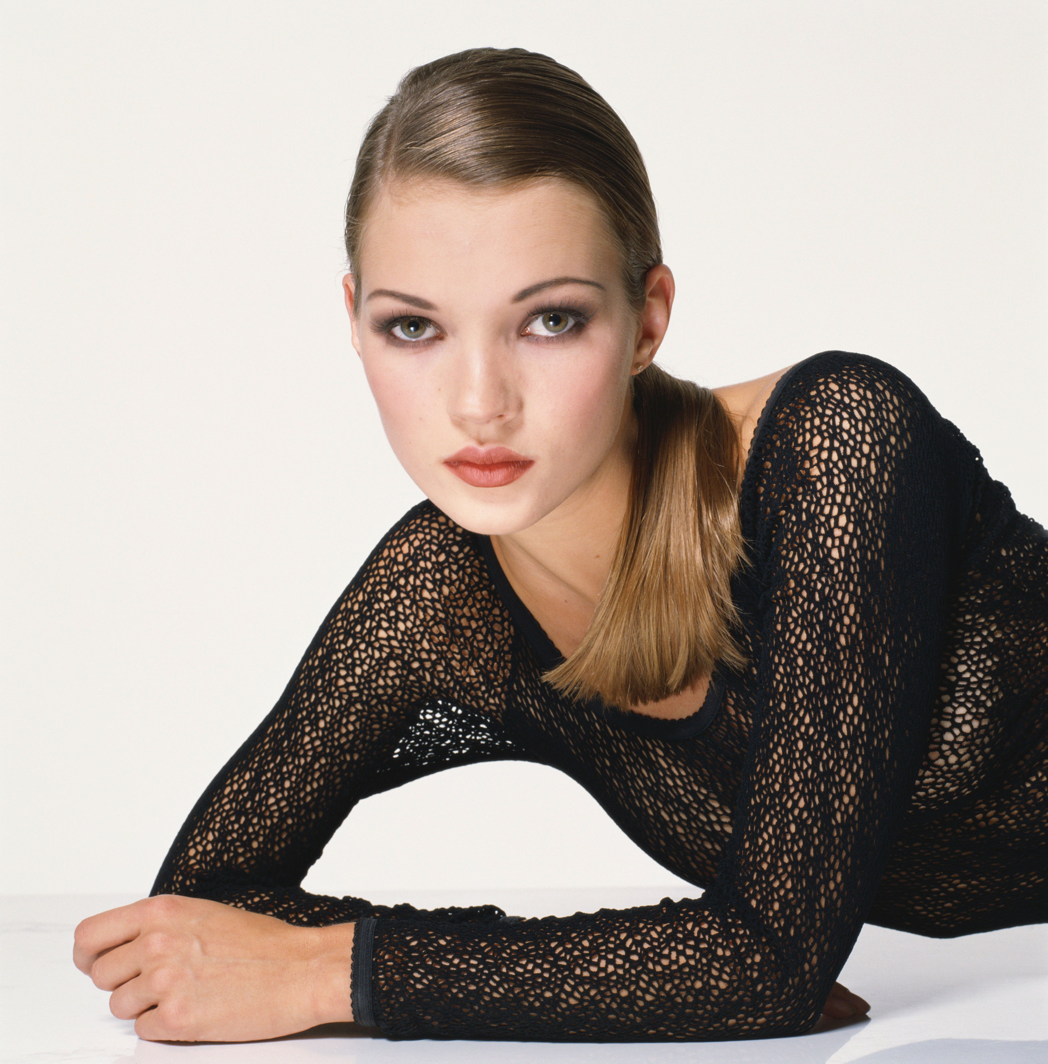 English supermodel Kate Moss, wearing a knitted black body stocking. (Photo by Terry O'Neill/Getty Images)