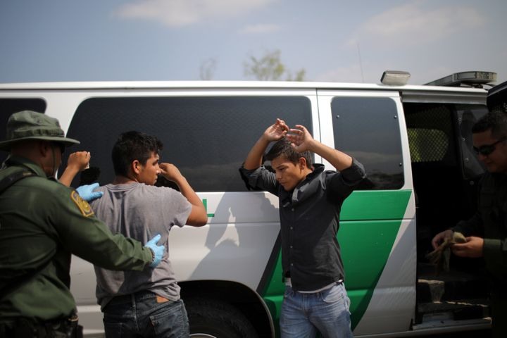 U.S. Border Patrol agents detain men in Roma, Texas, last May after they entered the U.S. by crossing the Rio Grand