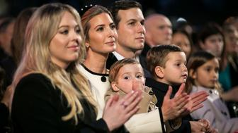 WASHINGTON, DC - NOVEMBER 30:  Ivanka Trump (C); her husband, senior White House adviser Jared Kushner, and their children Theodore, Joseph and Arabella; and Tiffany Trump (L) look on before the lighting ceremony U.S. President Donald Trump and first lady Melania Trump participate in the 95th annual national Christmas tree held by the National Park Service on the Ellipse near the White House on November 30, 2017 in Washington, D.C. (Photo by Al Drago-Pool/Getty Images)