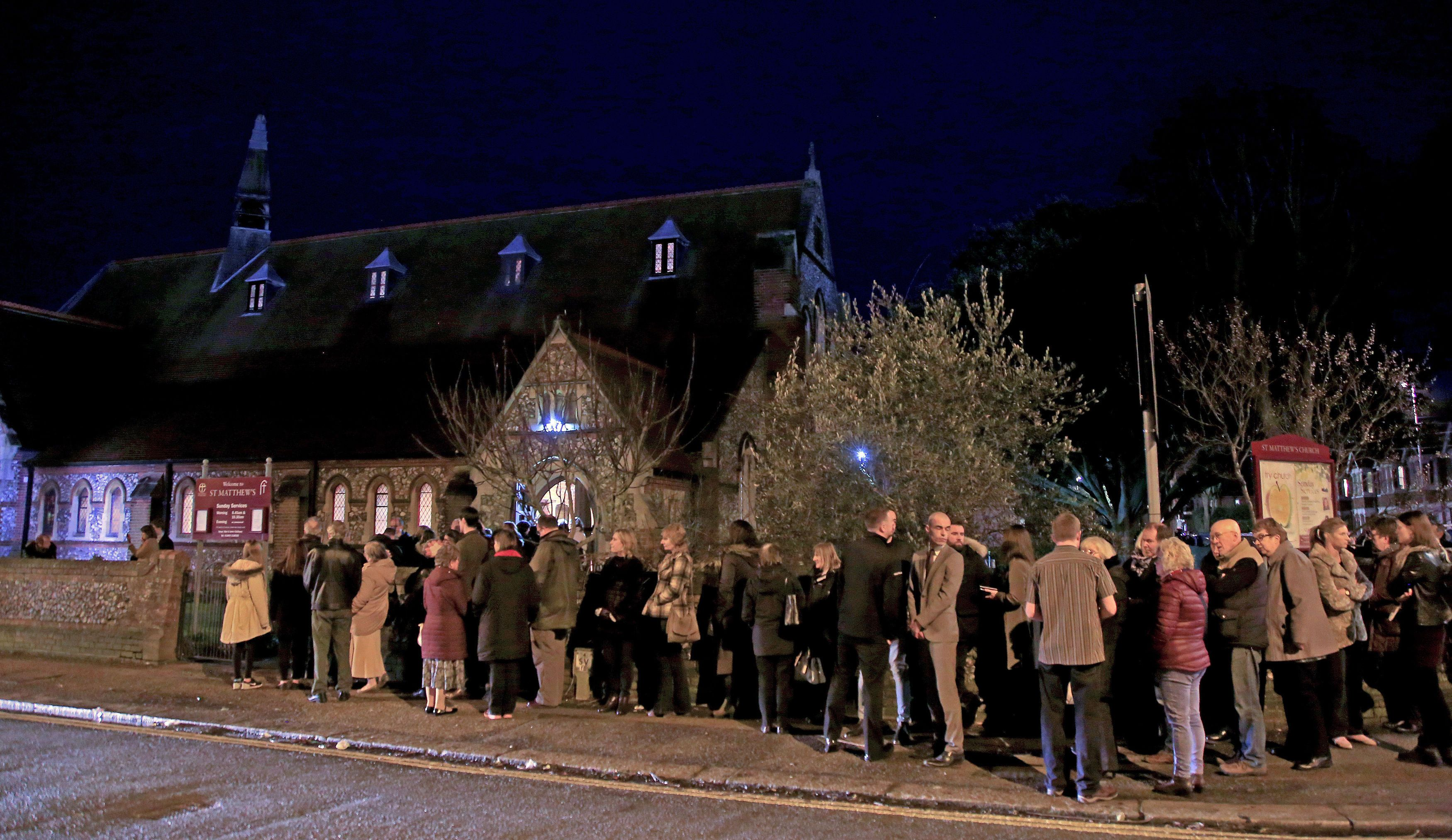 <strong>Mourners gather at St. Matthews Church in Worthing, West Sussex, for a memorial service for Stuart and Jason Hill, who were killed alongside Becky Dobson in a helicopter crash in the Grand Canyon.</strong>