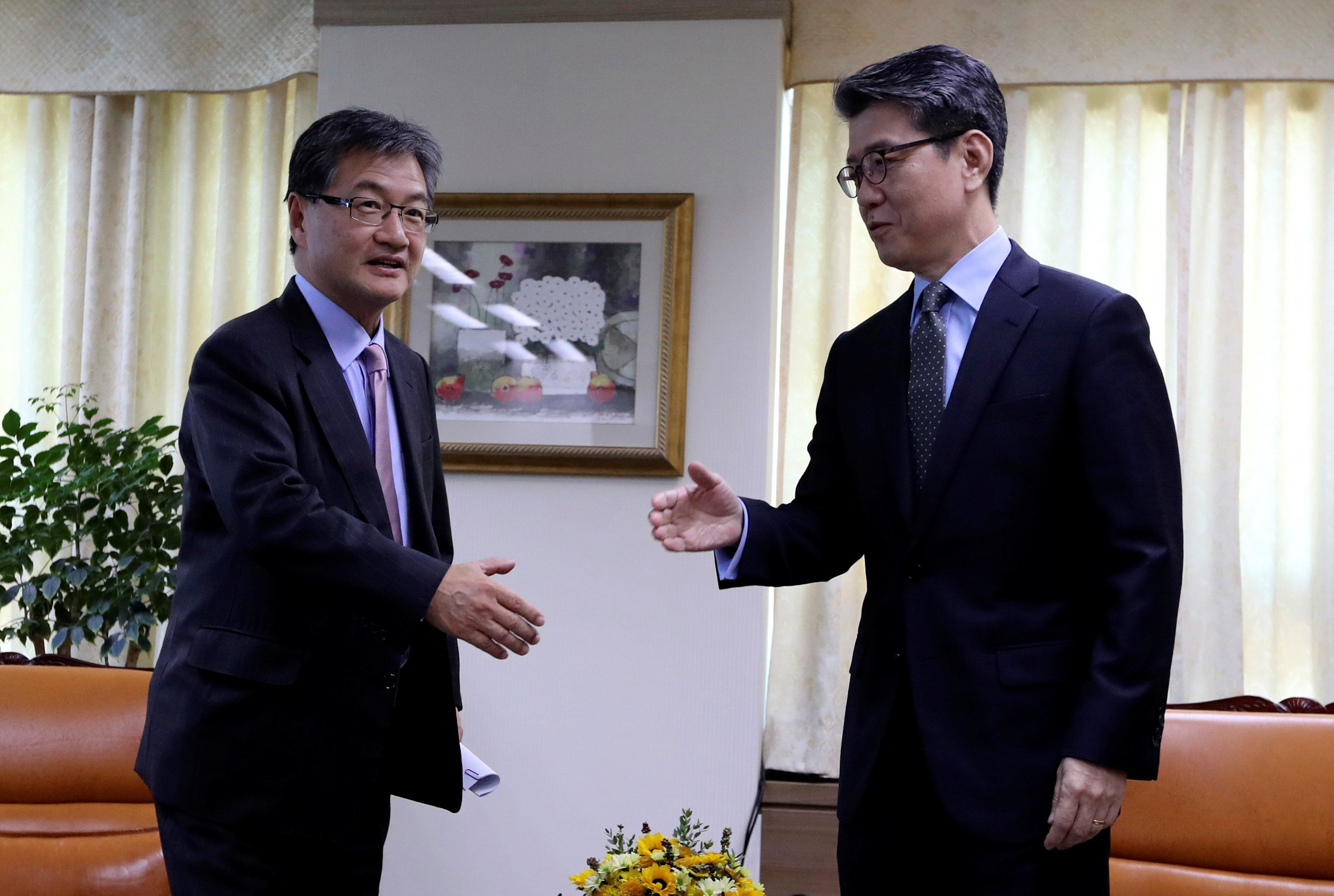 Joseph Yun, left, the State Department's top official on North Korea policy, will retire Friday. Here he meets with Sout