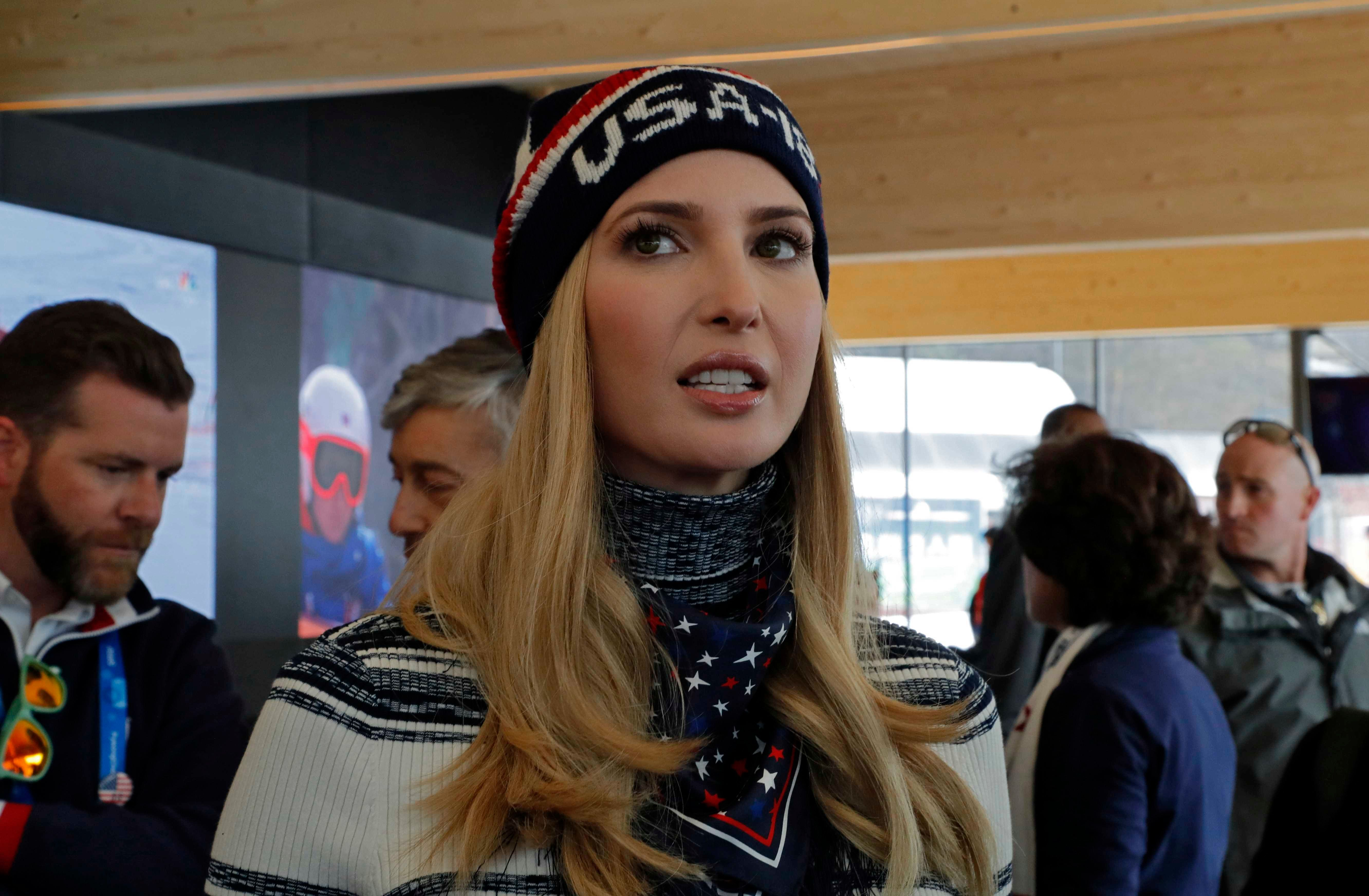 US President Donald Trump's daughter and senior White House adviser Ivanka Trump arrives to meet with former US bobsledder Garrett Hines (R) at the USA's house in pyeongchang on February 24, 2018. / AFP PHOTO / POOL / ERIC GAILLARD        (Photo credit should read ERIC GAILLARD/AFP/Getty Images)