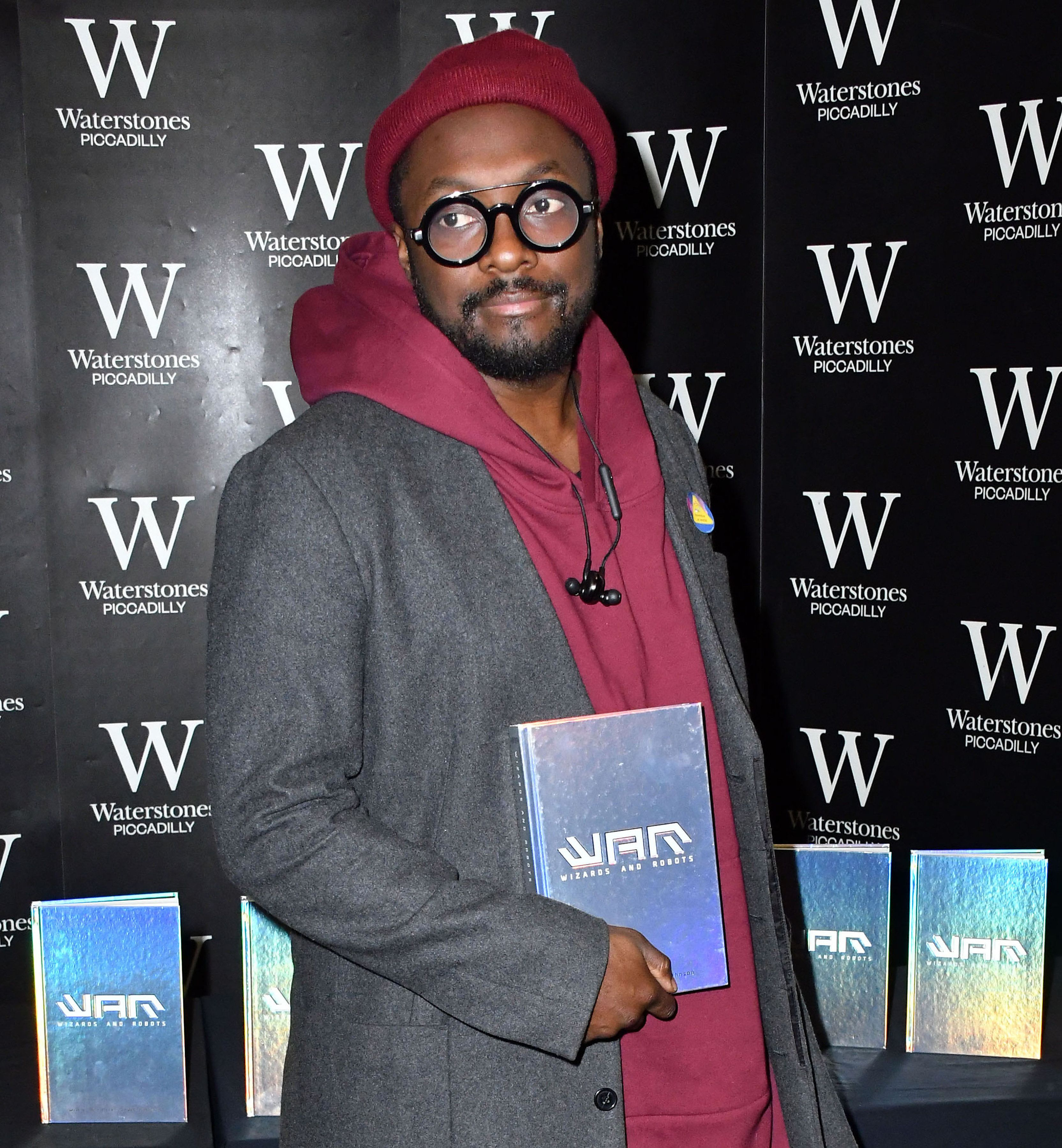 Will.i.am Fans Granted Refund  After 'Signed' Books Were Autographed By 'Robotic Device'