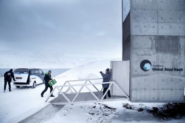 Boxes containing seeds from Japan and the U.S.are seen being carried into the seed vault in