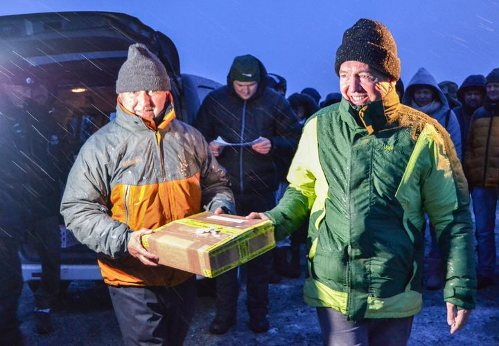 Ivan Matus (L) and Fernando Ortega from Chile carry a package containing seeds from their country to deposit at the Global Seed Vault on Monday.