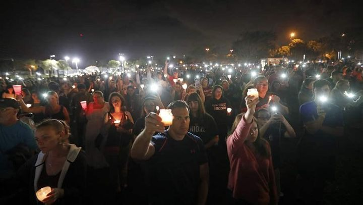 A candlelight vigil in memory of the 17 students and faculty who were killed in the mass shooting at Marjory Stoneman Douglas