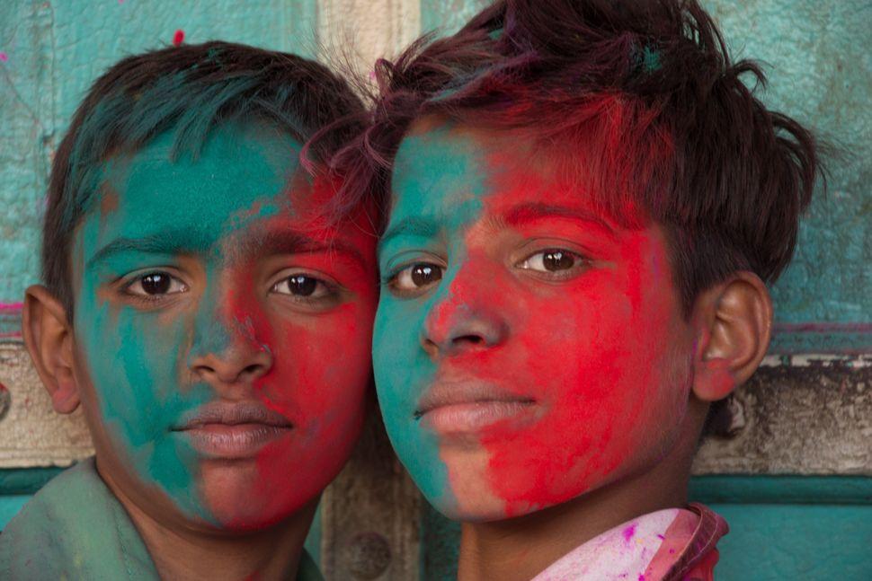 Children celebrate Holi in Uttar Pradesh.