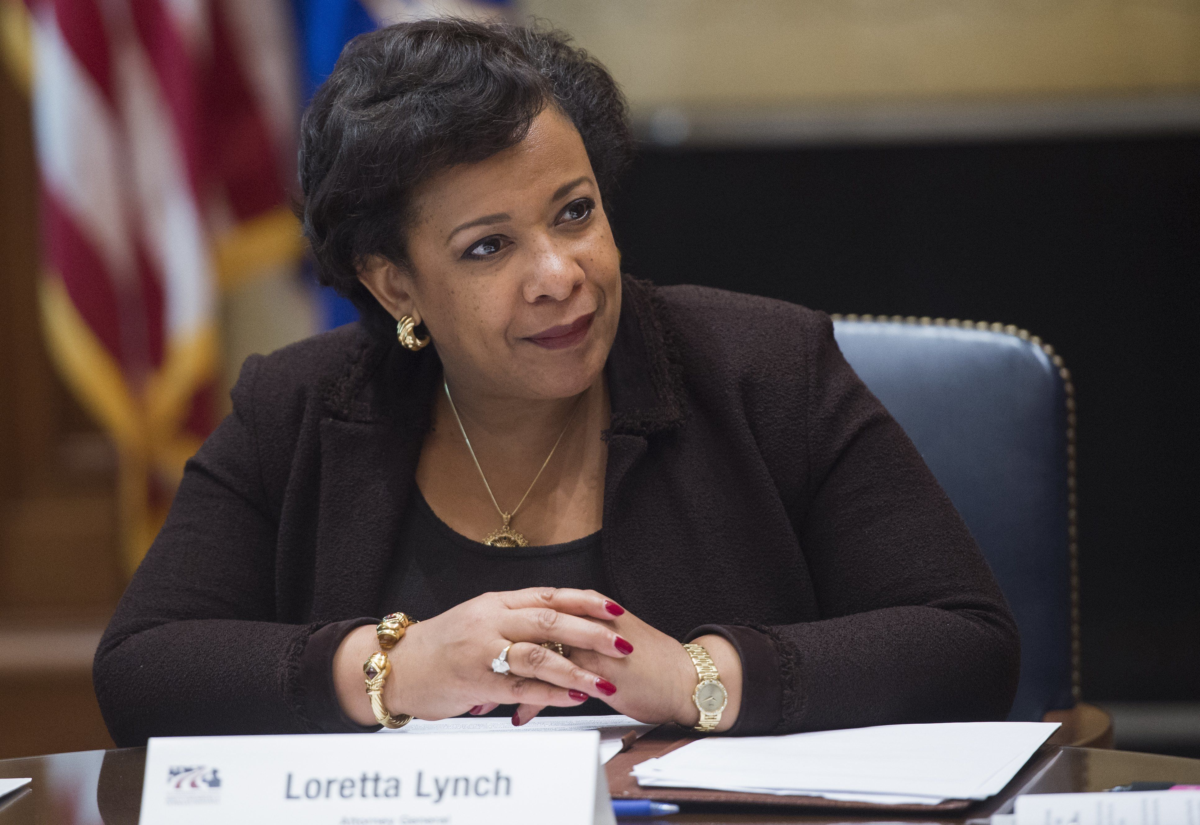 US Attorney General Loretta Lynch attends a roundtable meeting about the US Department of Justice's Servicemembers and Veterans Initiative, which helps with legal issues and protect the rights of servicemembers, veterans and their families, at the Department of Justice in Washington, DC, November 2, 2016. / AFP / SAUL LOEB        (Photo credit should read SAUL LOEB/AFP/Getty Images)