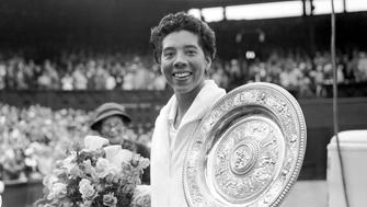 Althea Gibson shows off the Ladies' Singles trophy after her straight sets victory over Angela Mortimer  (Photo by Barratts/PA Images via Getty Images)