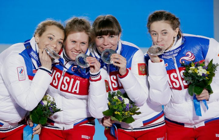 Silver medalists Olga Zaitseva, far left, Yana Romanova, Ekaterina Shumilova and Olga Vilukhina of Russia pose during the cer
