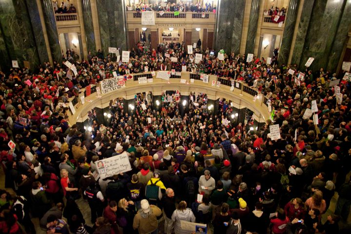 Protesters took over the Wisconsin state capitol building after Republicans voted to eliminate the state's historic public se