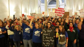 Workers inside the West Virginia state capitol on Monday