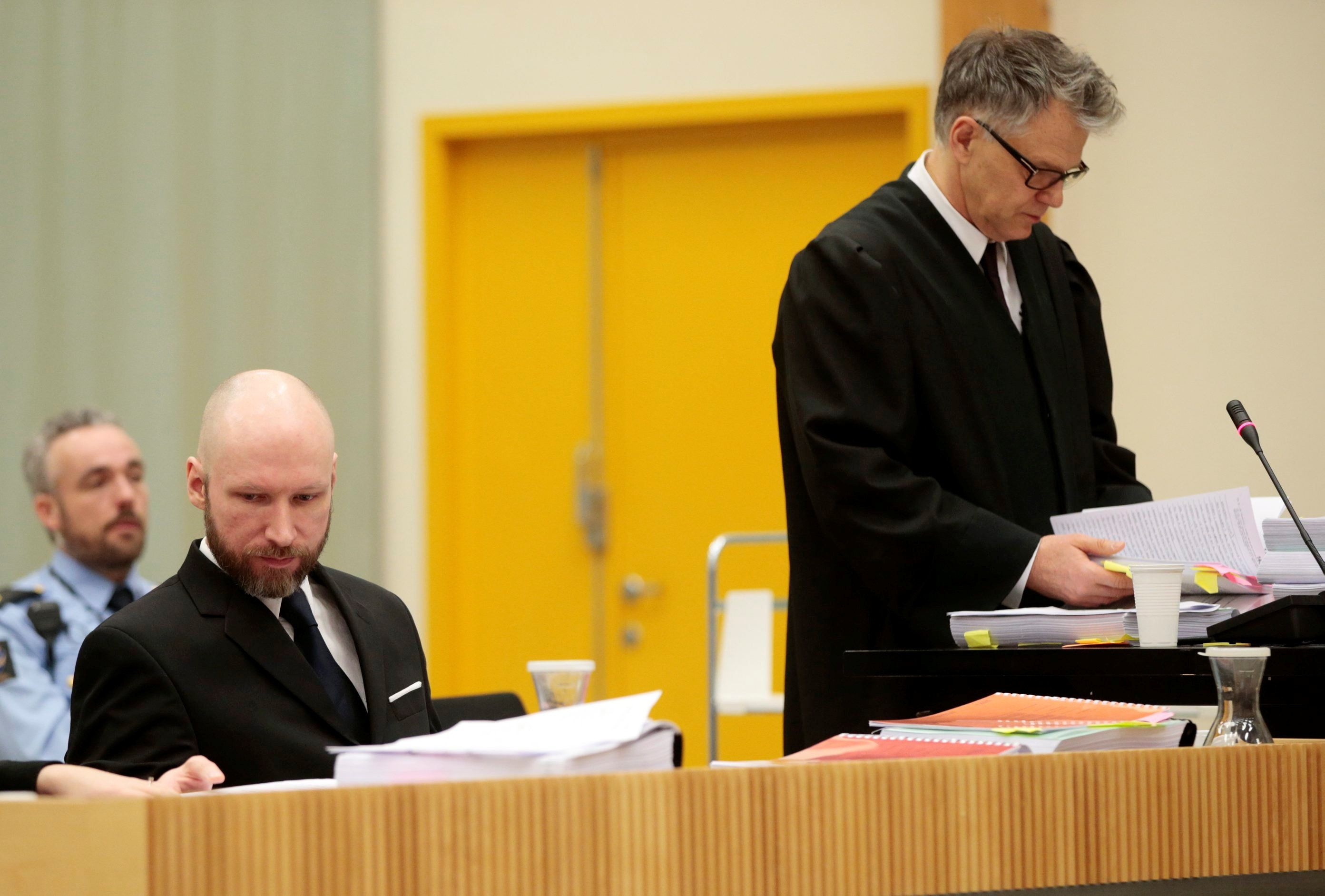 Anders Behring Breivik and his lawyer Oystein Storrvik (R) are seen on the third day of the appeal case in Borgarting Court of Appeal at Telemark prison in Skien, Norway January 12, 2017. NTB Scanpix/Lise Aaserud/via REUTERS      ATTENTION EDITORS - THIS IMAGE WAS PROVIDED BY A THIRD PARTY. FOR EDITORIAL USE ONLY. NORWAY OUT. NO COMMERCIAL OR EDITORIAL SALES IN NORWAY.