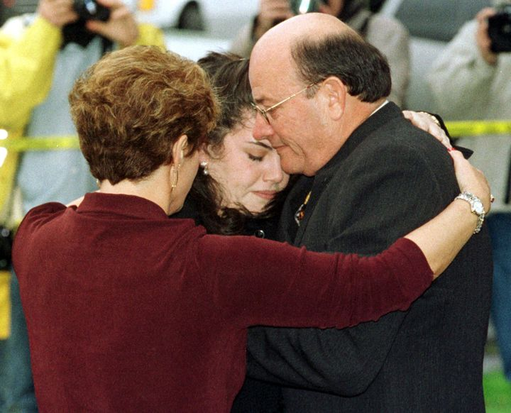 Moica Lewinsky is hugged by her father, Bernard, and an unidentified woman in February 1998.