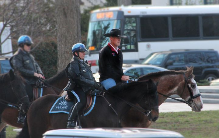 Interior Secretary Ryan Zinke rides a horse to his first day of work at the Interior Department on March 2, 2017.