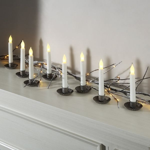 """Get them <a href=""""https://www.amazon.com/Flameless-LampLust-Finished-Candlesticks-Batteries/dp/B00FL3PRBS?tag=thehuffingtop-2"""