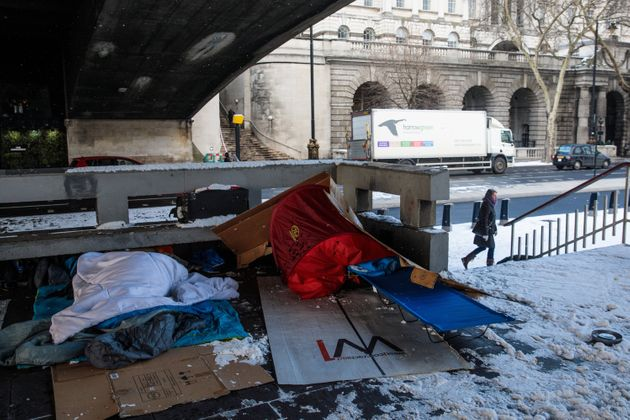 Bedding and shelters belonging to homeless people lie under a bridge on the Embankment on