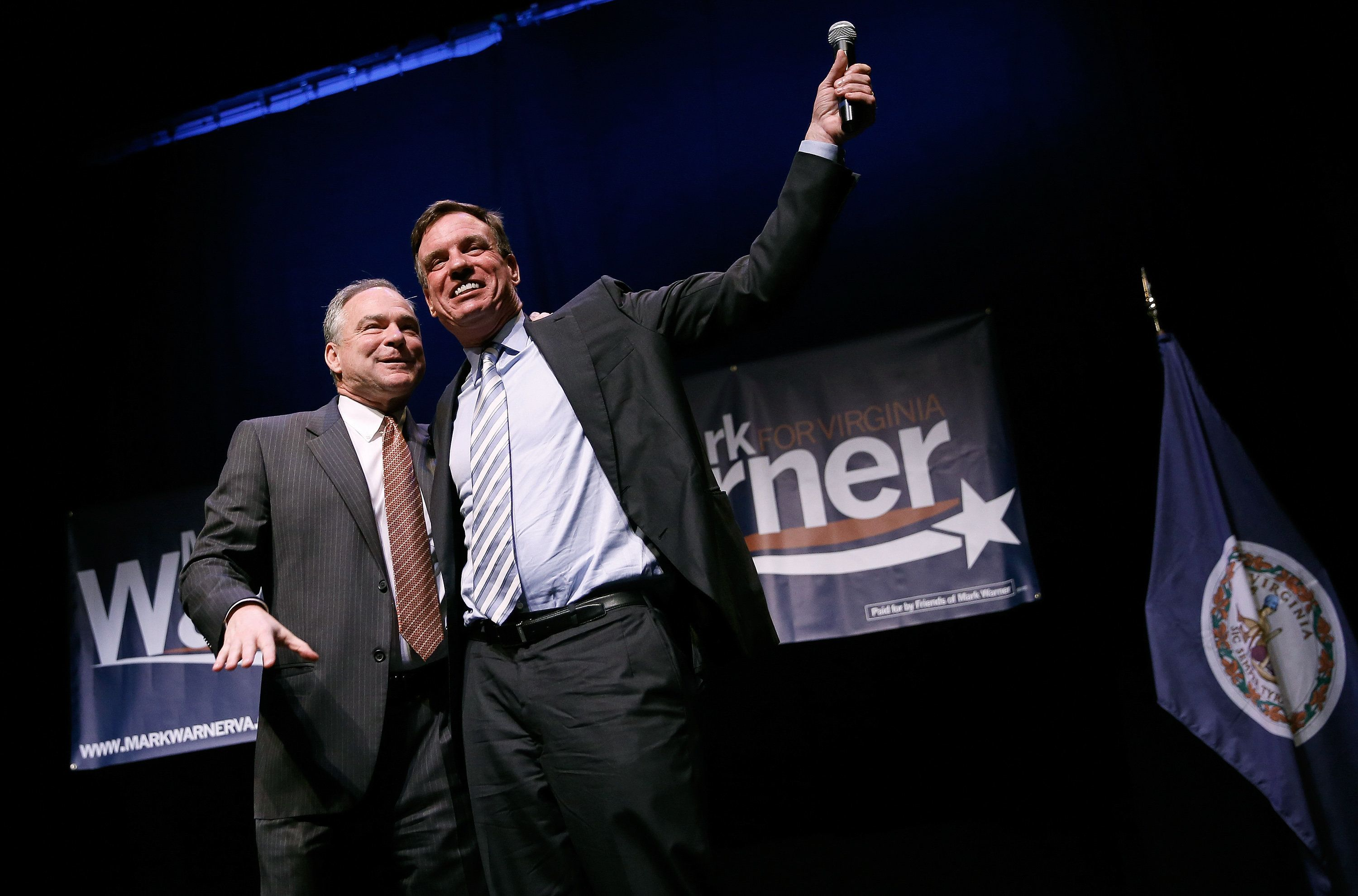 WASHINGTON, DC - MAY 29:  Sen. Mark Warner (D-VA) is introduced by Sen. Tim Kaine (D-VA) during Warner's re-election kickoff rally May 29, 2014 in Arlington, Virginia. Warner is likely to face former Republican National Committee Chairman Ed Gillespie in the general election in November.  (Photo by Win McNamee/Getty Images)