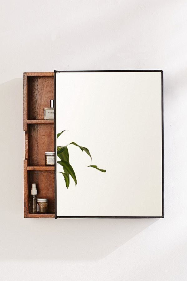 "With three interior shelves, a sliding unit, and a mirror on the front, <a href=""https://www.urbanoutfitters.com/shop/plymout"