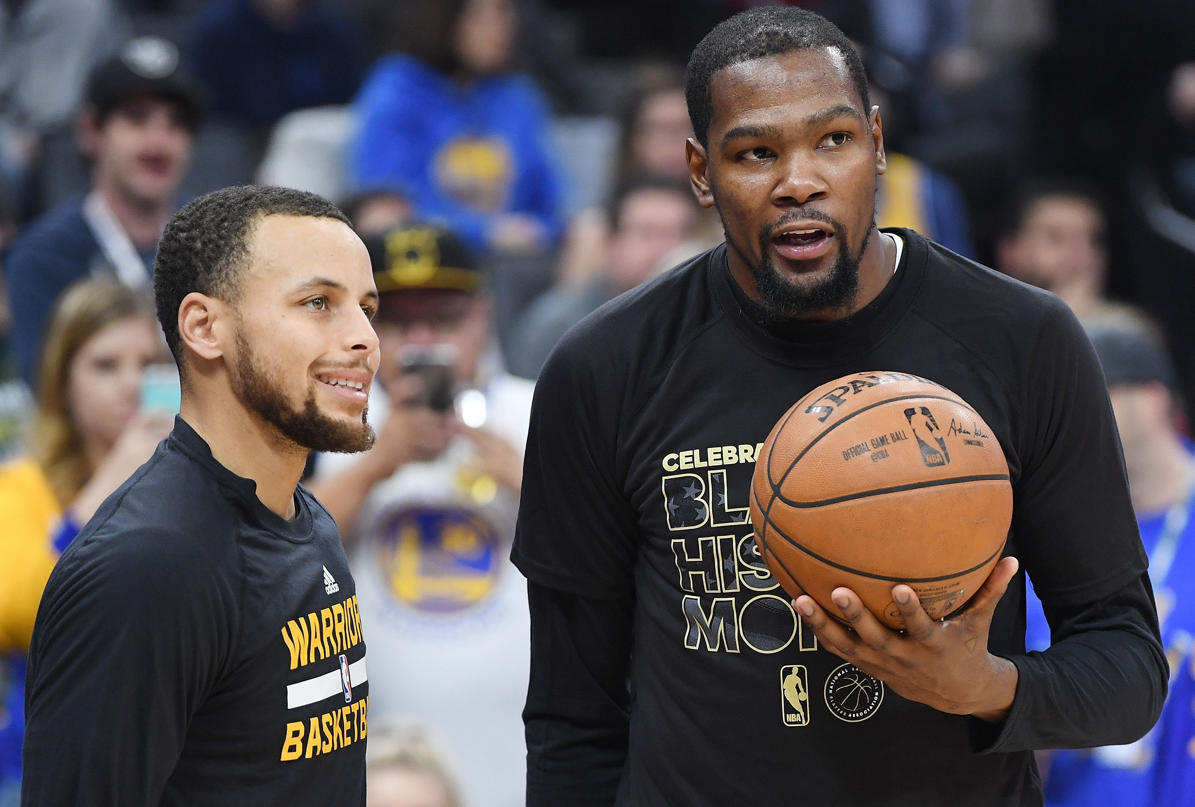 SACRAMENTO, CA - FEBRUARY 04:  Stephan Curry #30 (L) and Kevin Durant #35 (R) of the Golden State Warriors talks with each other during warm ups prior to the start of an NBA basketball game against the Sacramento Kings at Golden 1 Center on February 4, 2017 in Sacramento, California. NOTE TO USER: User expressly acknowledges and agrees that, by downloading and or using this photograph, User is consenting to the terms and conditions of the Getty Images License Agreement.  (Photo by Thearon W. Henderson/Getty Images)