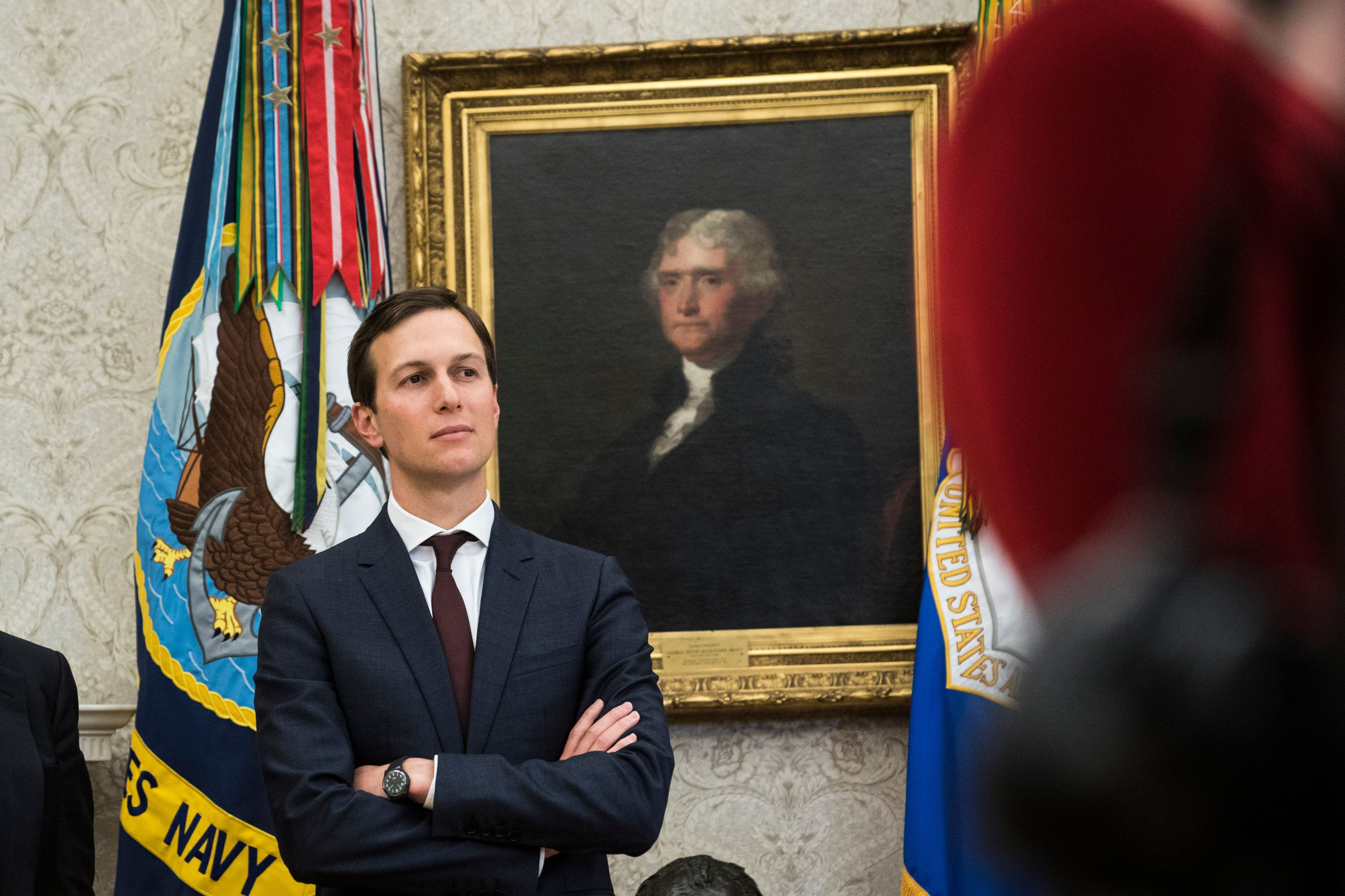 WASHINGTON, DC - JANUARY 9: White House adviser Jared Kushner watches as President Donald Trump signs the 'Supporting our Veterans during their Transition from Uniformed Service to Civilian Life,'executive order in the Oval Office at the White House in Washington, DC on Tuesday, Jan. 09, 2018. (Photo by Jabin Botsford/The Washington Post via Getty Images)