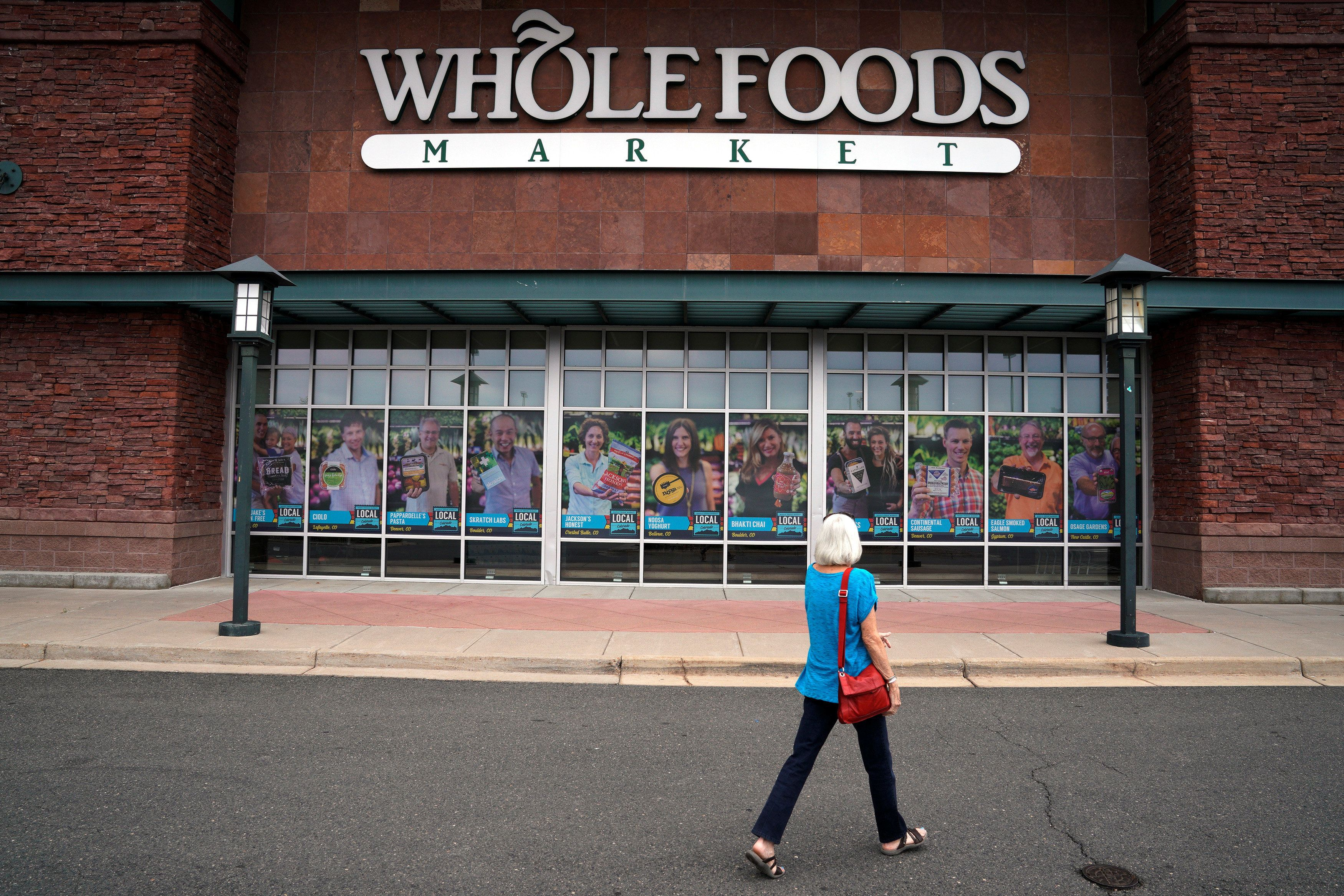 A customer enters the Whole Foods Market in Superior, Colorado on July 26, 2017. (REUTERS/Rick Wilking)