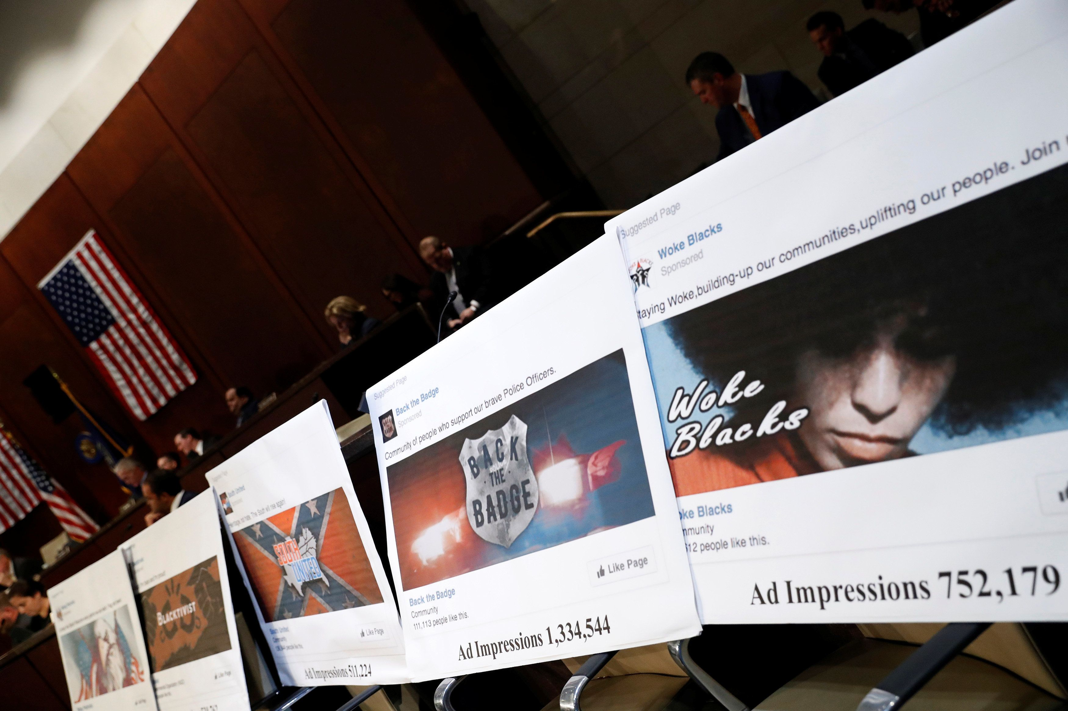 Examples of Facebook pages are seen, as executives appear before the House Intelligence Committee to answer questions related to Russian use of social media to influence U.S. elections, on Capitol Hill in Washington, U.S., November 1, 2017. REUTERS/Aaron P. Bernstein