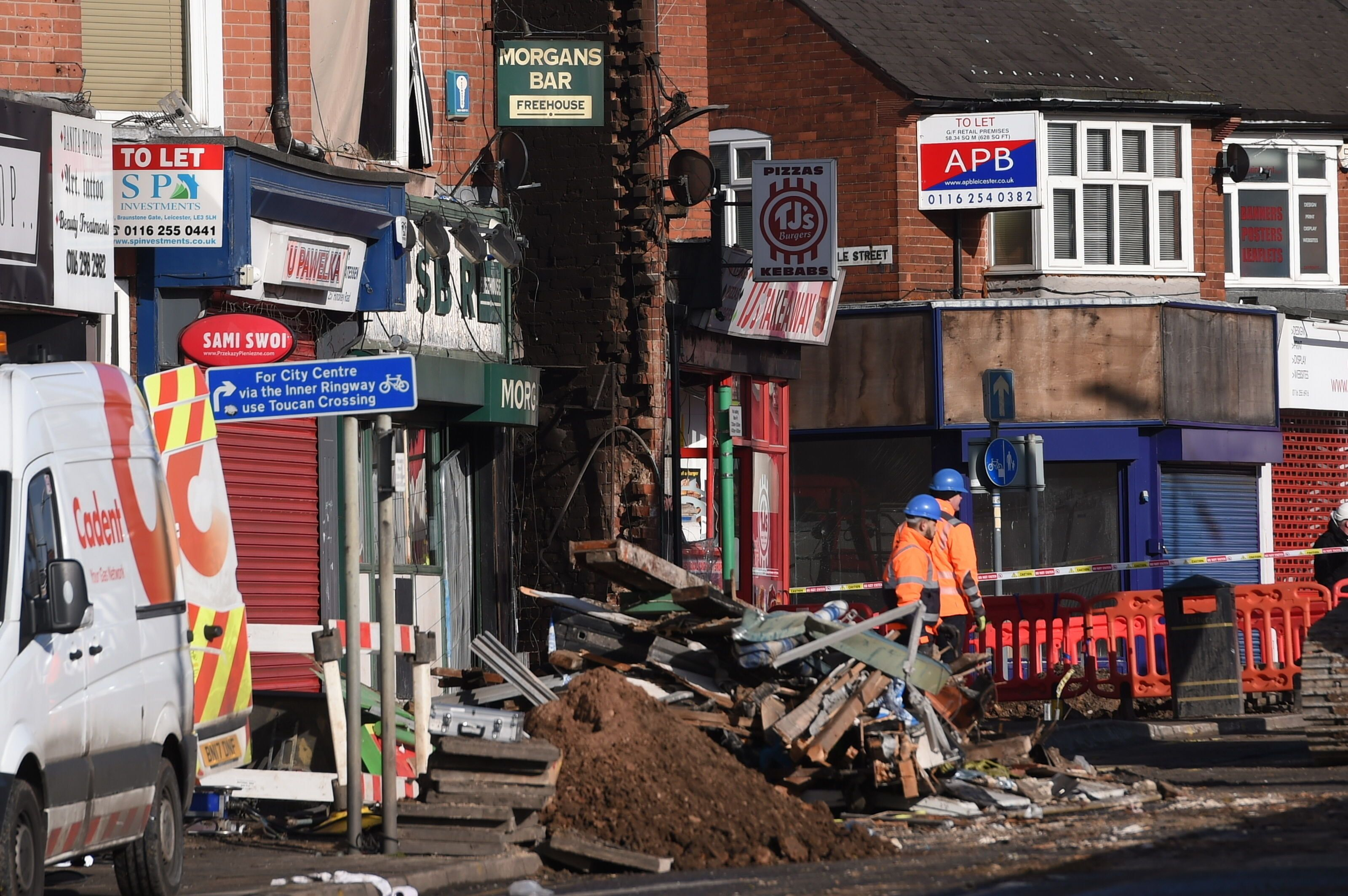 <strong>Emergency services work at the scene of the explosion.</strong>