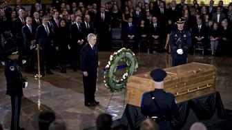 Senate Majority Leader Mitch McConnell, a Republican from Kentucky, stands near the casket of the late Reverend Billy Graham during a service at the U.S. Capitol Rotunda in Washington, D.C., U.S., on Wednesday, Feb. 28, 2018. Graham, the Christian evangelist who preached to more than 200 million people in 185 countries and became the confidant of world leaders including every U.S. president from Harry Truman to George W. Bush, died at age 99 on February, 21. Photographer: Andrew Harrer/Bloomberg via Getty Images
