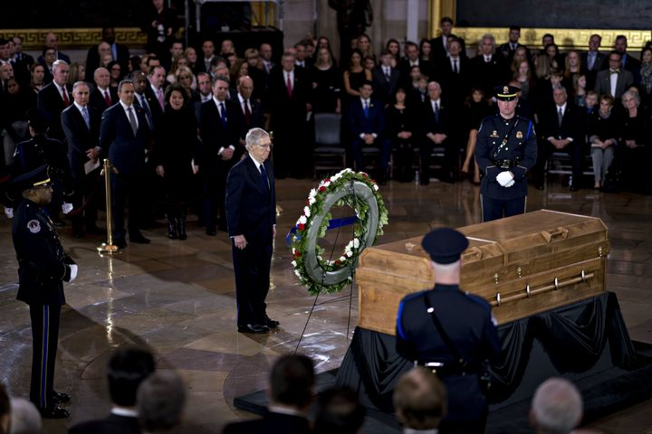 Senate Majority Leader Mitch McConnell (R-Ky.) stands near the casket of the late Rev. Billy Graham during a service at