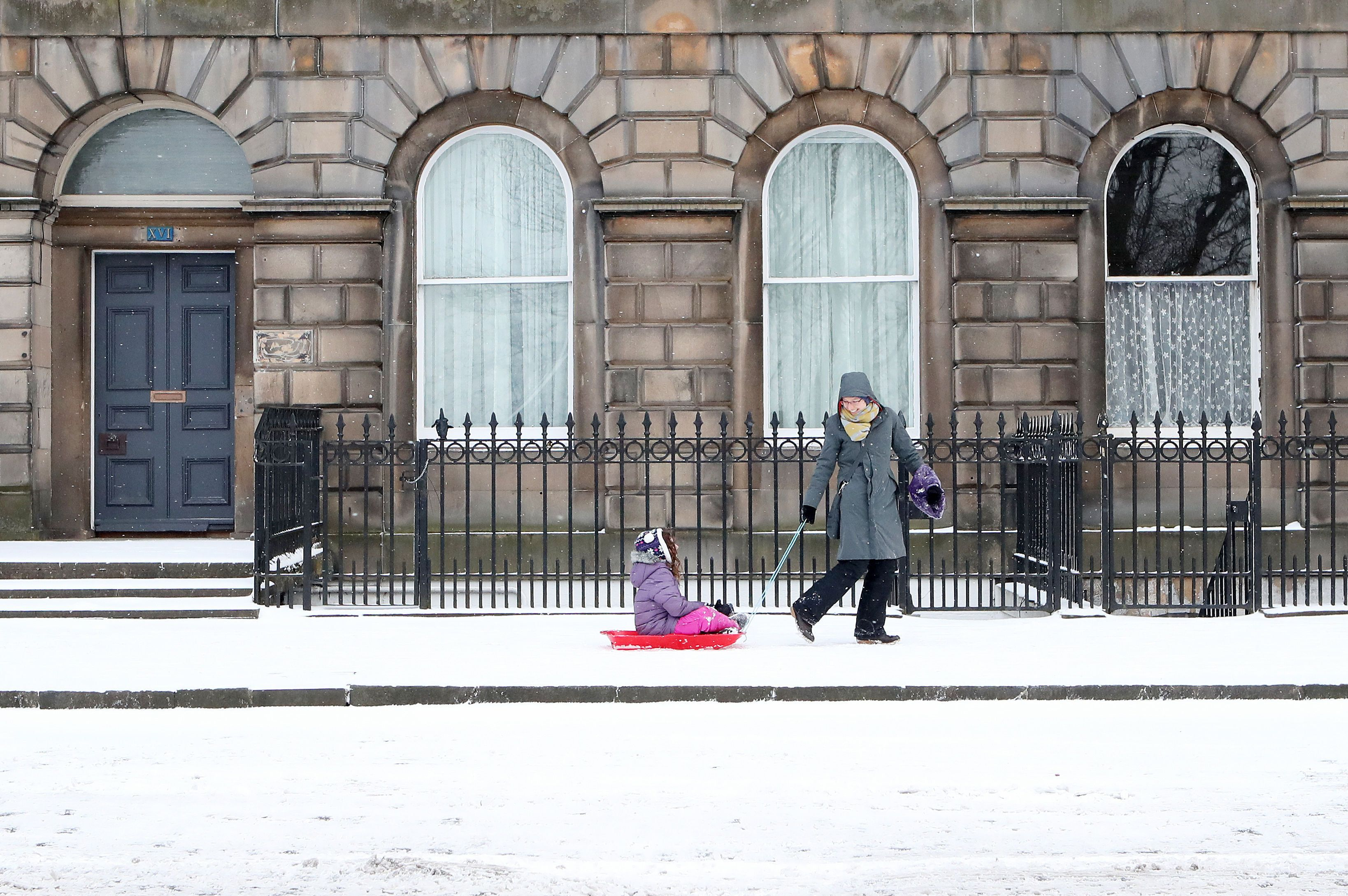 <strong>A child is pulled in a sledge along Royal Terrace in Edinburgh, as the 'Beast from the East' brings wintry weather and freezing temperatures to much of the country. </strong>