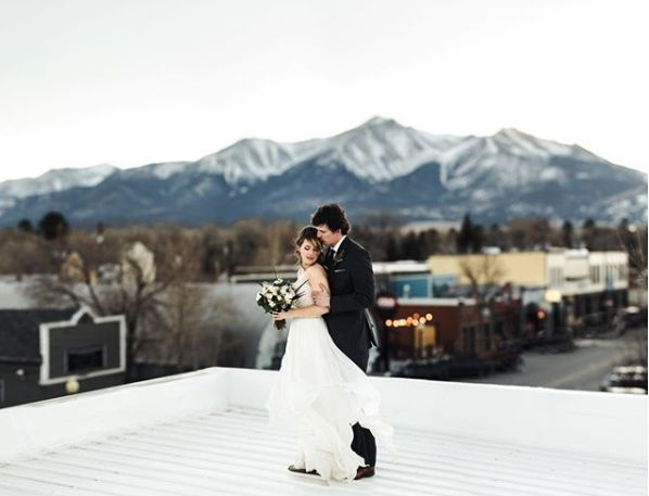 """Colorado rooftops, perfect winds, insane mountains and crazy love is the perfect recipe for one epic wedding portrait."" --&n"