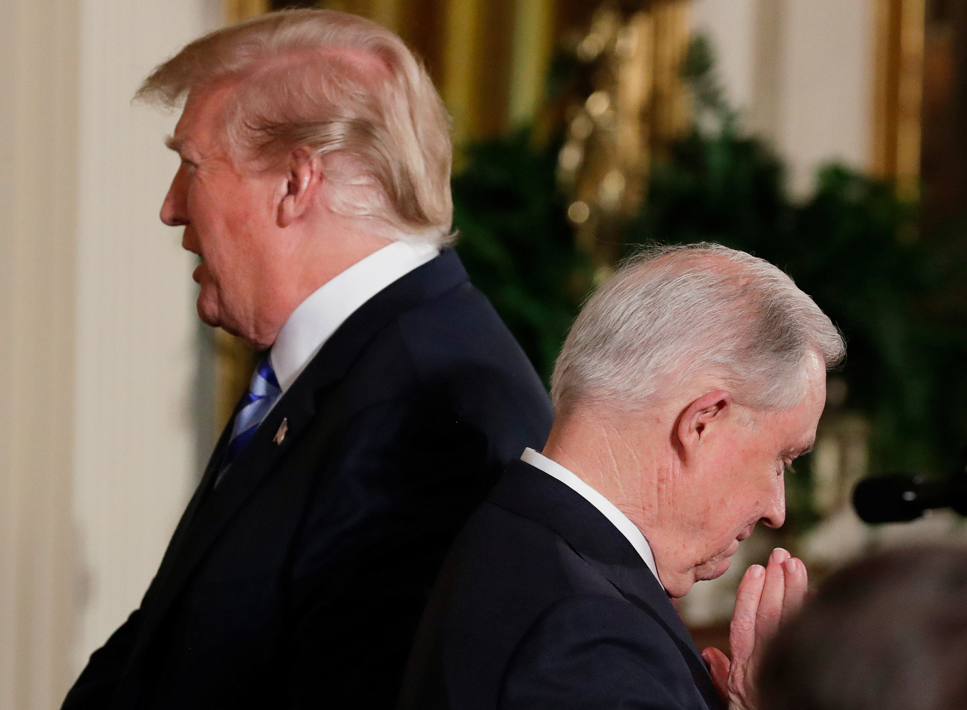 U.S. President Donald Trump and Attorney General Jeff Sessions (front) host a Public Safety Medal of Valor awards ceremony in the East Room of the White House in Washington, U.S., February 20, 2018. REUTERS/Jonathan Ernst     TPX IMAGES OF THE DAY