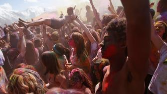 Participants crowd surf, dance and throw colored chalk during the Holi Festival of Colors at the Sri Sri Radha Krishna Temple in Spanish Fork, Utah, March 30, 2013. According to organizers 50,000 people were expected to pack the temple grounds to celebrate Holi, the passing of winter to spring, and throw colorful powder throughout the day. REUTERS/Jim Urquhart (UNITED STATES - Tags: SOCIETY RELIGION)
