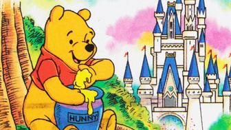 'Sacramento, California, USA - March 28, 2012: A 1996 Canada postage stamp depicting a contemporary Winnie the Pooh eating from a large jar labeled 'HUNNY' with Walt Disney World's Snow White castle in the background.'