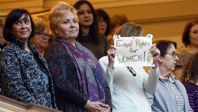 Supporters of the Equal Rights Amendment hold a sign as they are introduced in the gallery of the Virginia House earlier this
