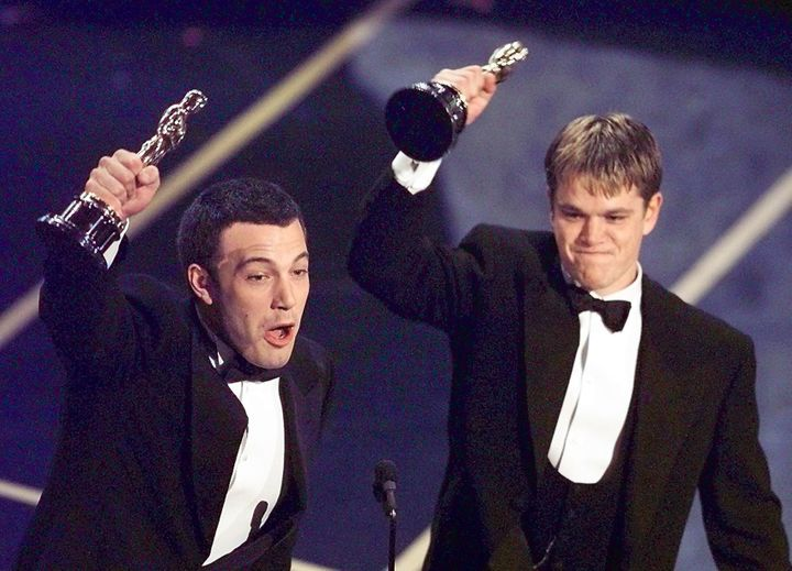 Ben Affleck and Matt Damon accept their awards for Best Original Screenplay at the 1998 Oscars.