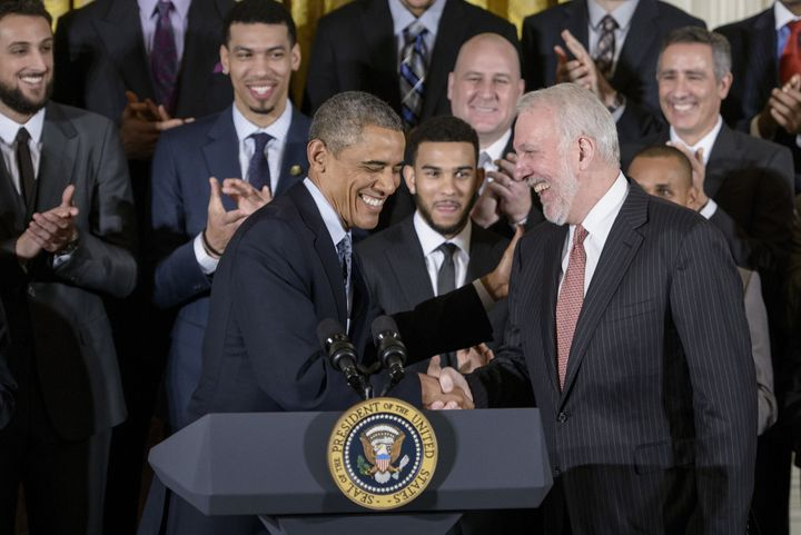 Then-President Barack Obama shares a laugh with San Antonia Spurs coach Gregg Popovich when the team visited the White House