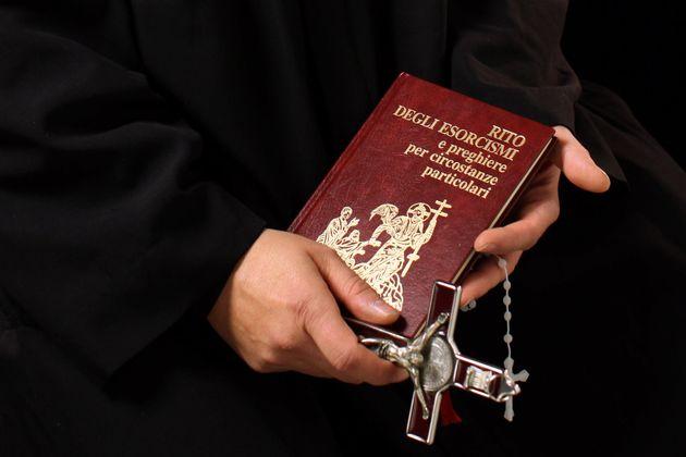 Don Aldo Buonaiuto holds items necessary for exorcisms on January 12, 2012, in Rome,