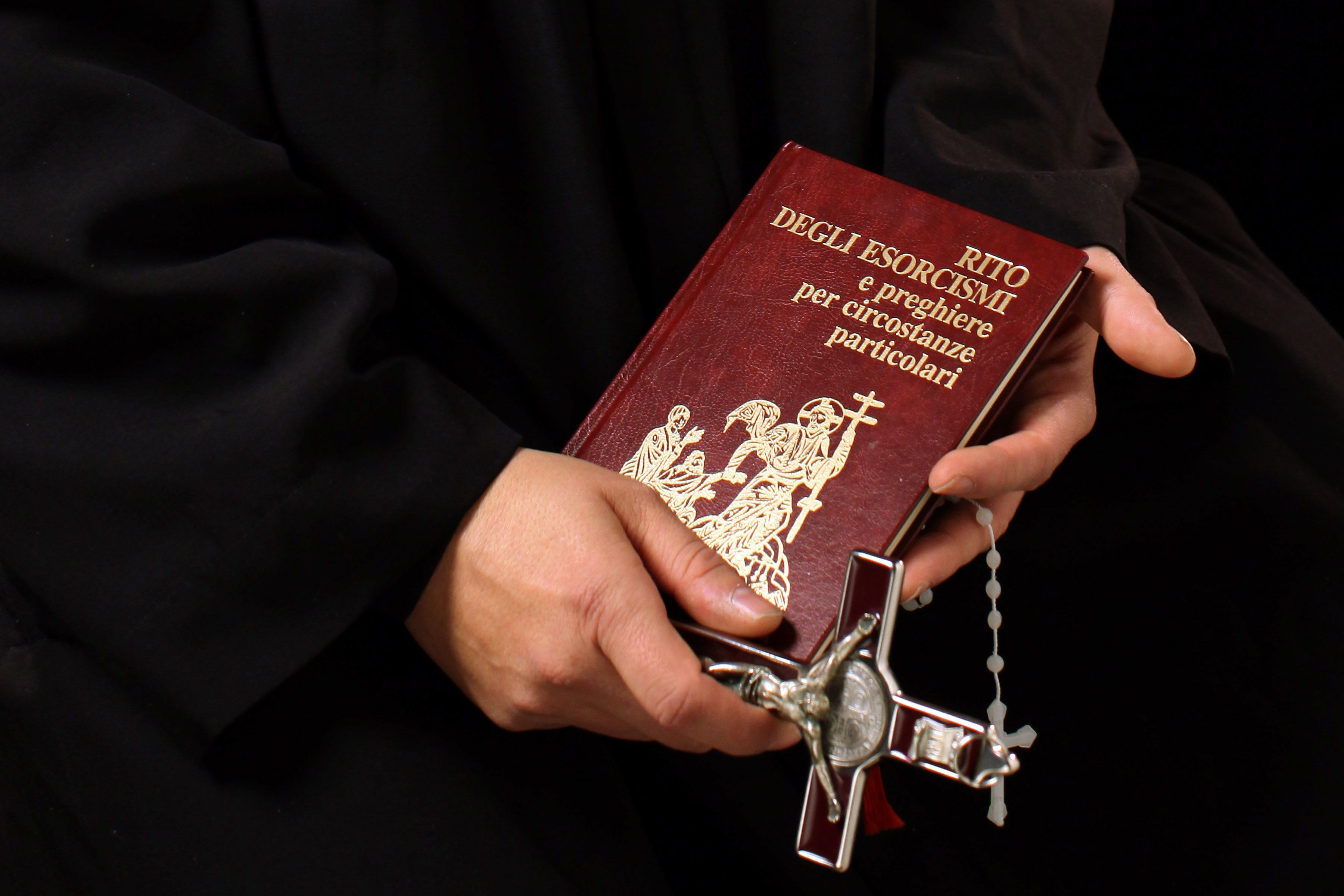 Don Aldo Buonaiuto holds items necessary for exorcisms on January 12, 2012, in Rome, Italy.
