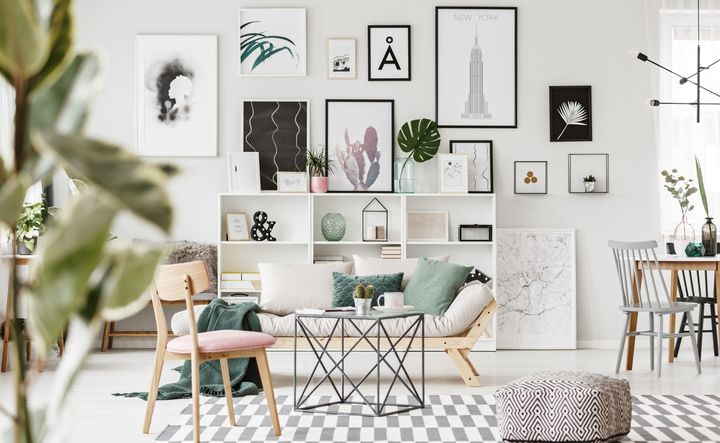 "I spy an <a href=""https://www.worldmarket.com/product/faux-monstera-leaf-stem.do"" target=""_blank"">oversized faux monstera leaf stem</a>."