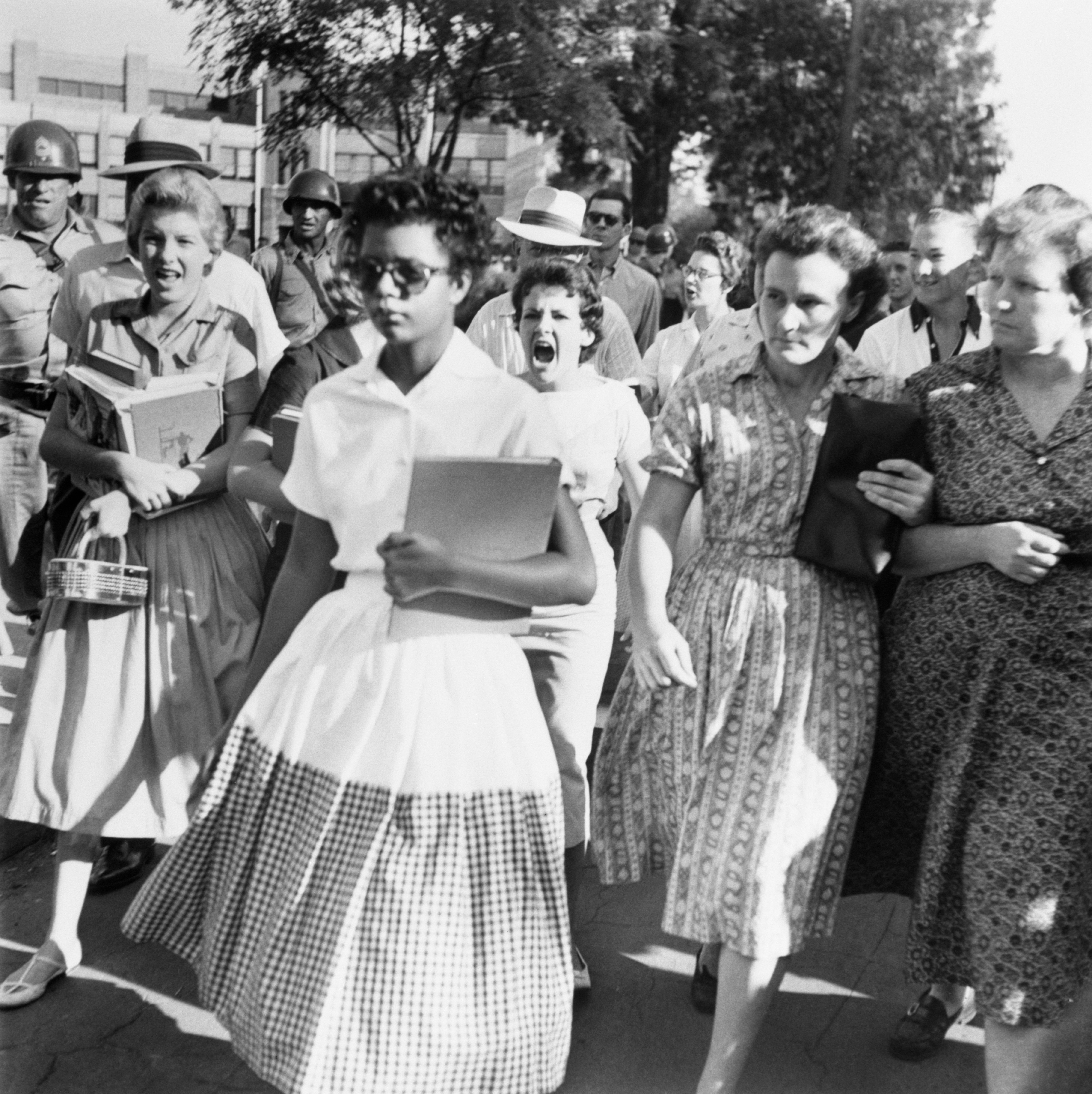 Elizabeth Eckford ignores the hostile screams and stares of fellow students on her first day of school. She was one of the nine negro students whose integration into Little Rock's Central High School was ordered by a Federal Court following legal action by NAACP.