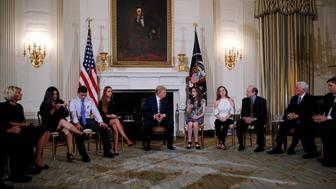U.S. President Donald Trump hosts a listening session with high school students and teachers to discuss school safety at the White House in Washington, U.S., February 21, 2018. REUTERS/Jonathan Ernst