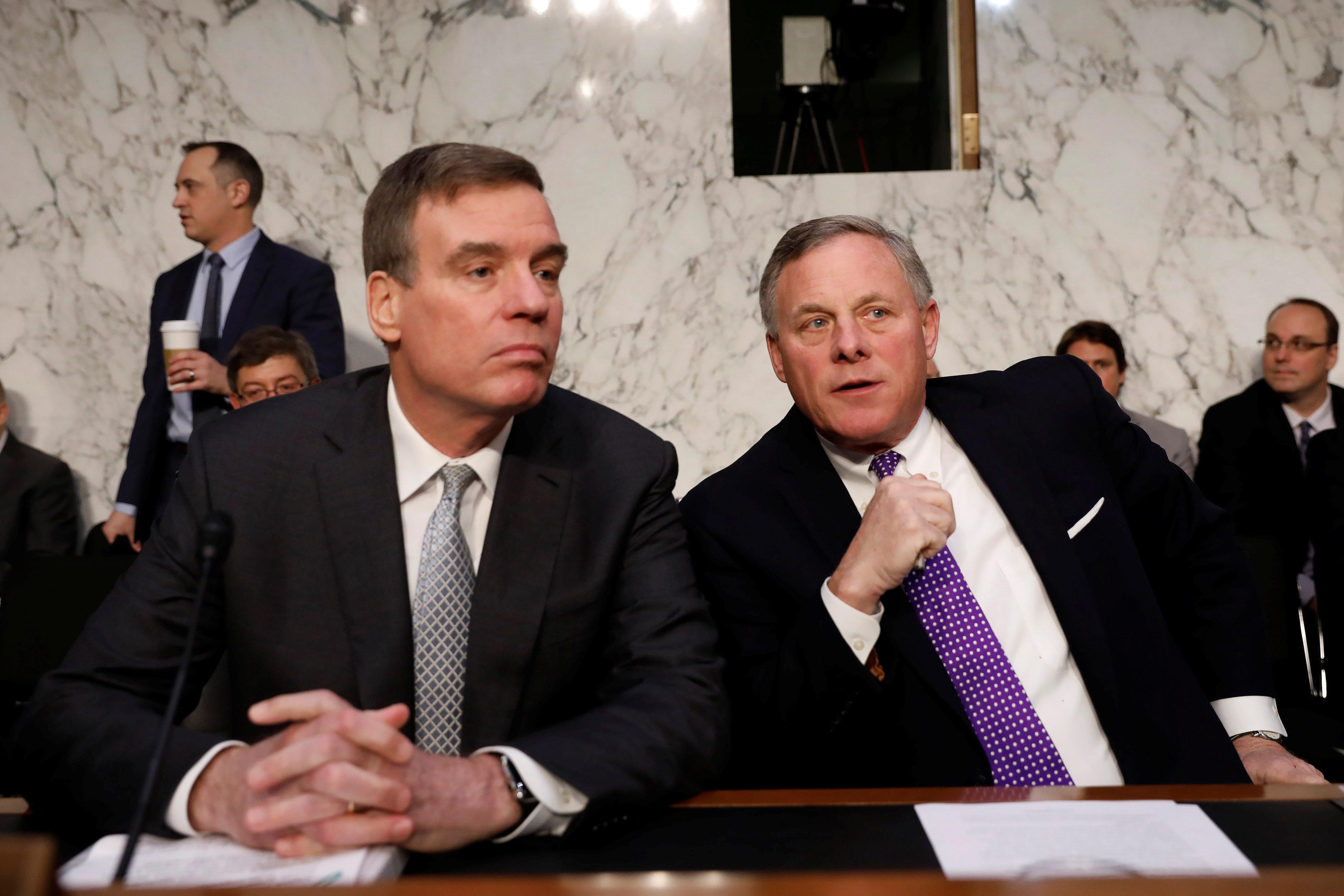 Democratic Sen. Mark Warner of Virginia (left) and Sen. Richard Burr, a North Carolina Republican, spoke to House Speaker Pau