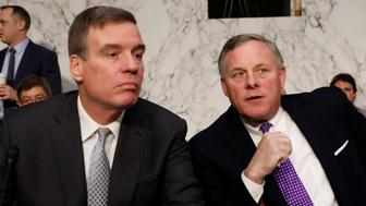 Senator Richard Burr (R-NC), at right, and Senator Mark Warner (D-VA) arrive prior to a hearing of the Senate Intelligence Committee on Capitol Hill in Washington, U.S., February 13, 2018. REUTERS/Aaron P. Bernstein