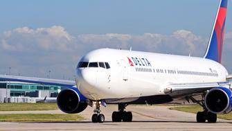 Manchester, United Kingdom - July 22, 2014:  Delta Boeing 767-332ER taxiing towards the airport runway, Manchester, Greater Manchester, England, UK, Western Europe.