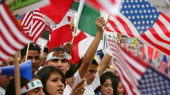 LOS ANGELES, CA - APRIL 15:  Students march to call for amnesty for illegal immigrants on April 15, 2006 in Los Angeles, California. The 3,000 people who marched through downtown to City Hall particularly oppose House bill HR 4437 by Rep. F. James Sensenbrenner, R-Wisconsin that would increase penalties for immigrant smuggling, beef up penalties for undocumented immigrants who re-enter the United States, and require employers to report Social Security numbers to the Department of Homeland Security. The march is dedicated to Ontario, California student Anthony Soltero, 14, who committed suicide on March 30 after a school administrator allegedly told him he would be fined and jailed for participating in a student walkout in support of undocumented immigrants rights on March 28.  (Photo by David McNew/Getty Images)
