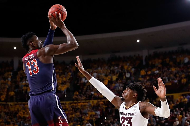 Deandre Ayton of the Arizona Wildcats, left, is at the center of accusations against coach Sean Miller.